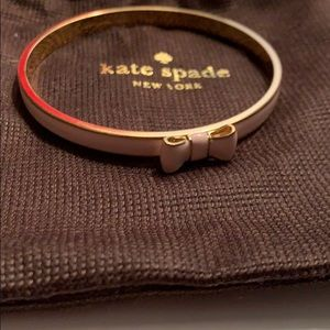 Pink and gold Kate spade bracelet with bag